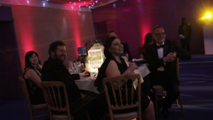 Simply Waste Solutions summer charity ball, table of six all smiling and looking towards stage