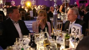 Simply Waste Solutions summer charity ball, three people at table talking over drinks