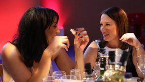 Simply Waste Solutions summer charity ball two women eating and chatting at table