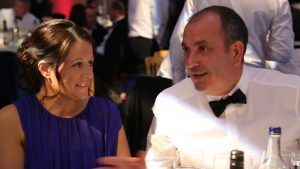 Simply Waste Solutions summer charity ball, man and woman talking at table
