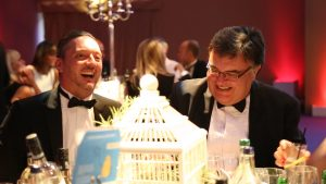 Simply Waste Solutions summer charity ball, two men laughing at table