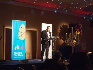 Simply Waste Solutions summer charity ball, James Capel on stage speaking to audience
