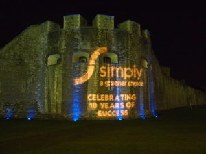 Simply Waste Solutions summer charity ball, logo lit up on outside of Tower of London