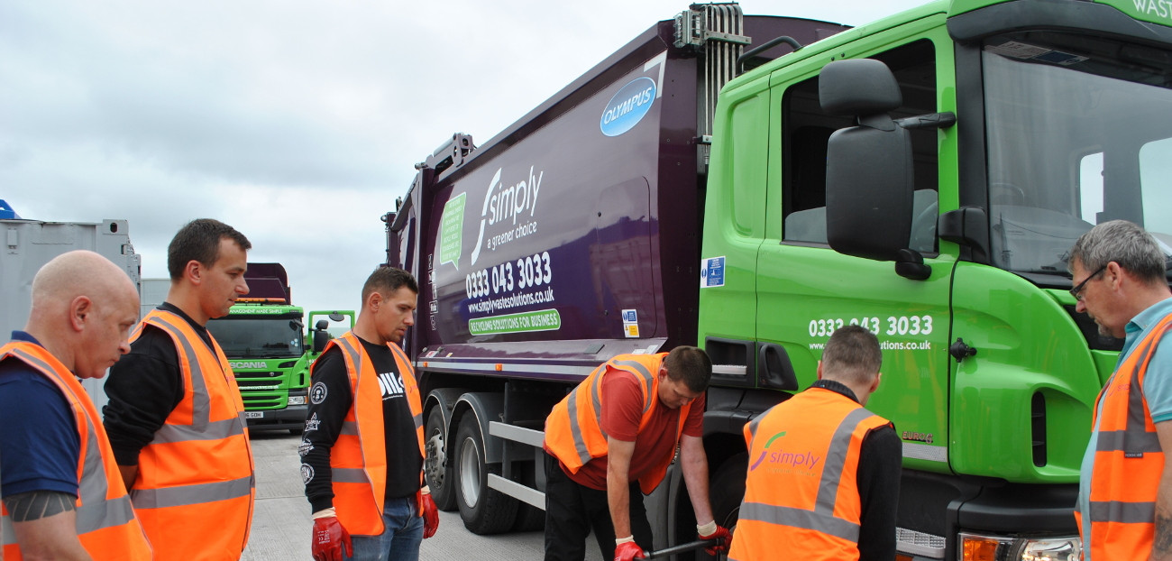 Simply Waste Solutions staff in vehicle training session