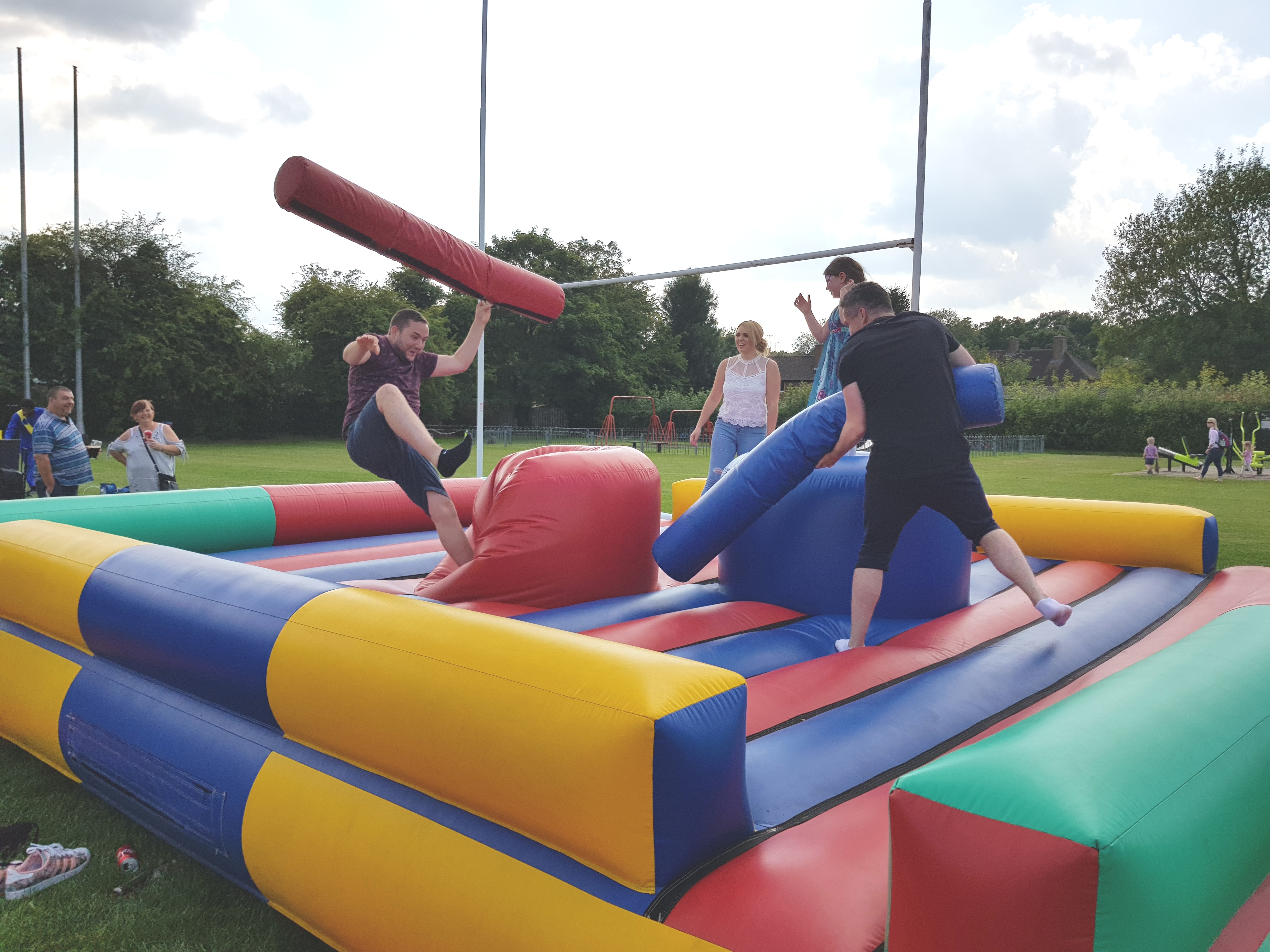 Simply Waste Solutions charity family fun day men on bouncy castle
