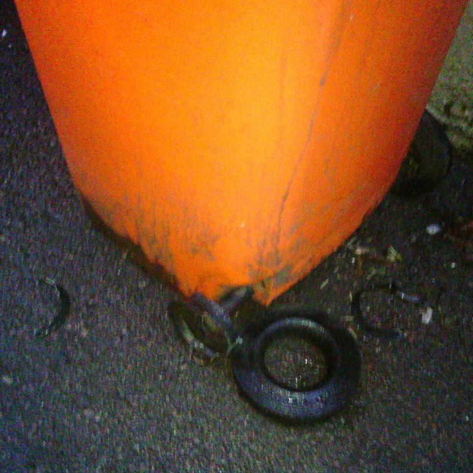 Wheelie bin with damaged wheel
