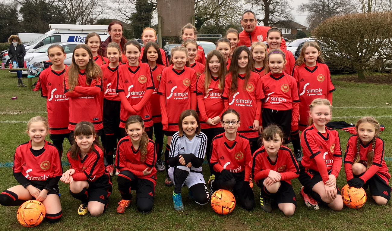 Flackwell Heath Minors Football Club (FHMFC) - girls team wearing Simply Waste Solutions sponsored t-shirts
