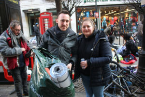Simply Waste Solutions driver, Cledwyn and Street Angels UK helper carry mats and sleeping bags