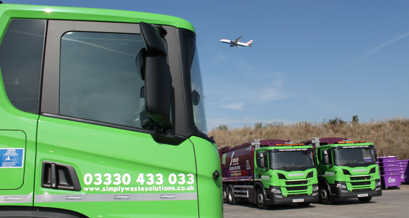 Simply Waste Solutions truck in Stanwell depot with Heathrow Airport plane flying over