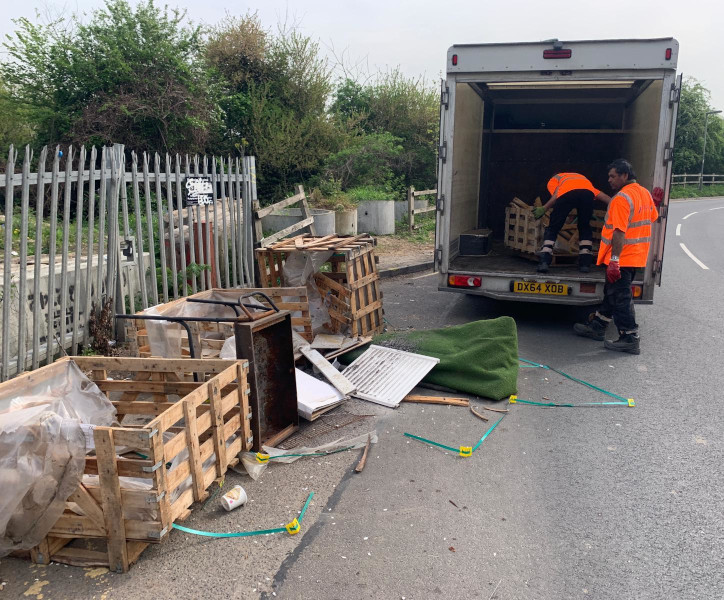 Simply Waste Solutions driver and loader clearing fly tipped waste