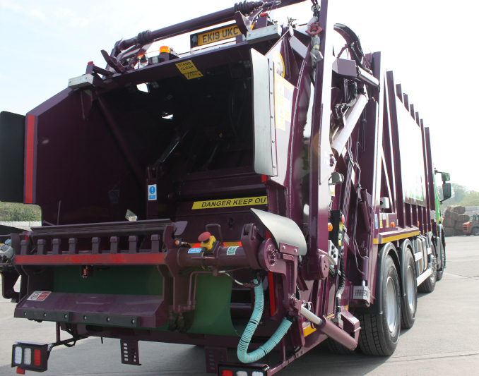 back of Simply Waste Solutions 2019 plate rear end loader (rel) truck