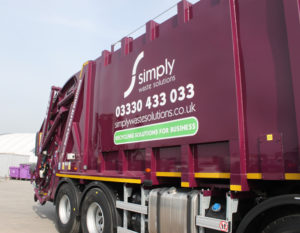 Side view of Simply Waste Solutions 2019 plate rear end loader (rel) truck