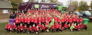 Flackwell Heath Minors FC (FHMFC) wearing Simply Waste Solutions' sponsored kits in front of a trade waste truck