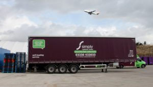 Simply Waste Solutions artic truck in Stanwell depot with plane flying over