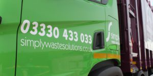 Simply Waste Solutions REL truck. Green cab with contact number and website address