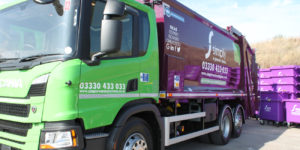 Simply Waste Solutions trade waste truck at Stanwell depot with 1100 Litre purple wheelie bins behind