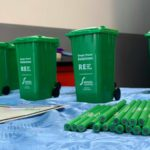 Recycling Roadshow at Banbury Station. Simply Waste Solutions merchandise of pencils and wheelie bins placed on table.