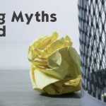 Debunking Recycling Myths. Paper next to waste bin