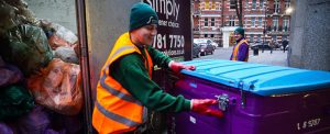 Simply Waste Solutions driver emptying 1100 litre wheelie bin