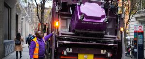 Simply Waste Solutions driver tipping wheelie bin into trade waste truck