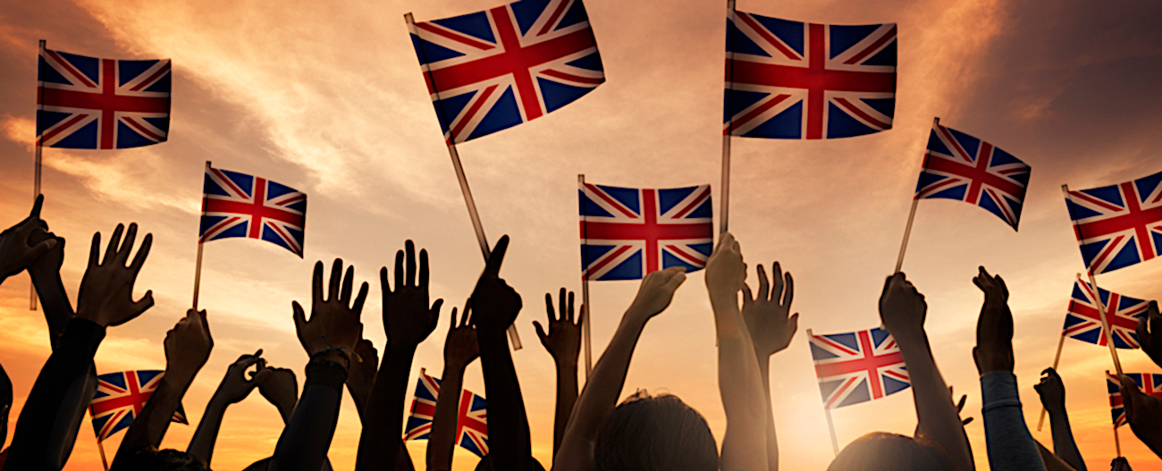 Silhouettes of People Holding National Flag of UK