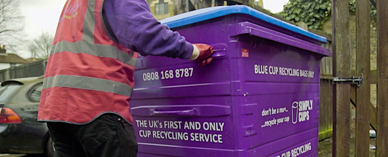 Simply Waste Solutions driver pulling 1100 litre cup recycling wheelie bin