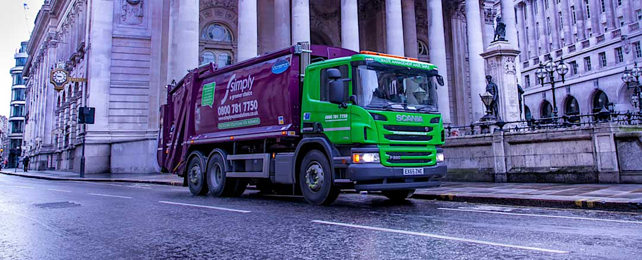 filtered Simply Waste Solutions trade waste truck on road