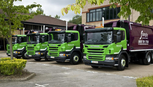 Simply Waste Solutions parked 12 plate registration trucks
