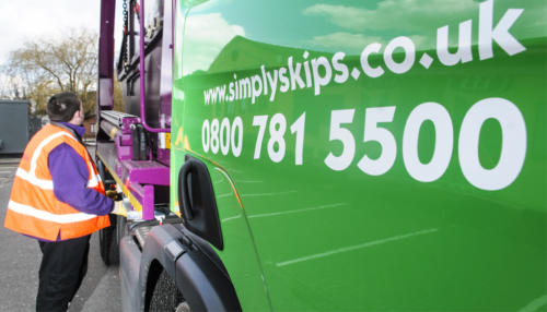 Simply Waste Solutions branding on a skip lorry