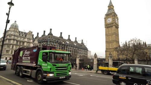 Trade Waste truck round in London, next to Big Ben