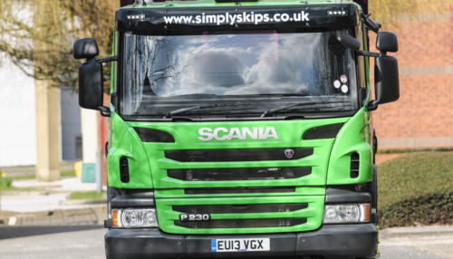Front view of a Simply Waste Solutions 13 plate skip lorry