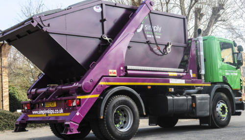 Skip lorry collecting business waste