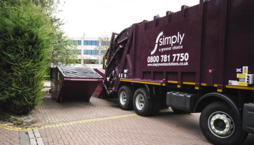 Rear End Loader (REL) containers having waste collected by Simply Waste Solutions truck