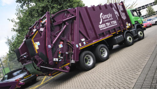 Side view of a Simply Waste Solutions Rear End Loader (REL)