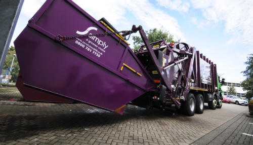 Rear End Loader (REL) collecting container waste