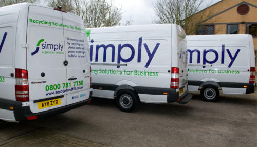 row of Simply Waste Solutions 11 plate vans parked up