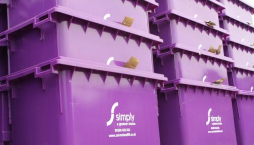 Stacked 1100 litre residual waste bins
